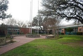 Front of school with flag poles